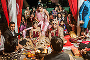 Indian Wedding Ceremony The bride and groom in the centre Photographed in Delhi, India