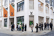 Shoppers queue outside Louis Vuitton as they return to the exclusive shopping area on Bond Street as non-essential shops reopen and the national coronavirus lockdown three eases on 15th April 2021 in London, United Kingdom. Now that the roadmap for coming out of the national lockdown has been laid out, this is the first phase of the easing of restrictions, and large numbers of people are out in Londons retail district laden with shopping bags.