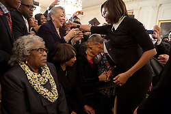 "President Barack Obama kisses the cheek of Ms. Mattie Atkins as he and First Lady Michelle Obama greet audience members during a reception celebrating Black History Month in the East Room of the White House, Feb. 26, 2015. Ms. Atkins was a ""foot soldier"" in the civil rights marches in Marion, Ala. in 1965. (Official White House Photo by Pete Souza)<br /> <br /> This official White House photograph is being made available only for publication by news organizations and/or for personal use printing by the subject(s) of the photograph. The photograph may not be manipulated in any way and may not be used in commercial or political materials, advertisements, emails, products, promotions that in any way suggests approval or endorsement of the President, the First Family, or the White House."