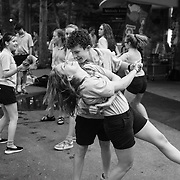 High School Musical Theater students Jackson Alexander, of Atlanta, and Caroline Stewart, 17 , of Atalanta, dance during a impromptu dance party outside the Melody Freeze concession stand in The Mall at Interlochen Center for the Arts in Interlochen, Michigan.  Stewart was celebrating her seventeenth birthday with some ice cream and dance tunes.