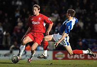 Photo: Daniel Hambury.<br />Portsmouth v Liverpool. The FA Cup. 29/01/2006.<br />Portsmouth's goal scorer Sean Davis (R) tackles Liverpool's Jan Kromkamp.