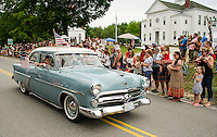 """The Mini family are """"KRUZ-N"""" the Gilmanton 4th of July parade route in style in their 1952 Ford on Saturday morning.  (Karen Bobotas/for the Laconia Daily Sun)"""