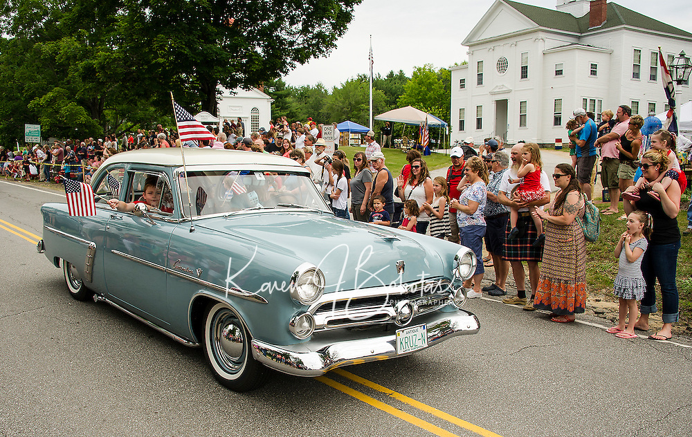 "The Mini family are ""KRUZ-N"" the Gilmanton 4th of July parade route in style in their 1952 Ford on Saturday morning.  (Karen Bobotas/for the Laconia Daily Sun)"