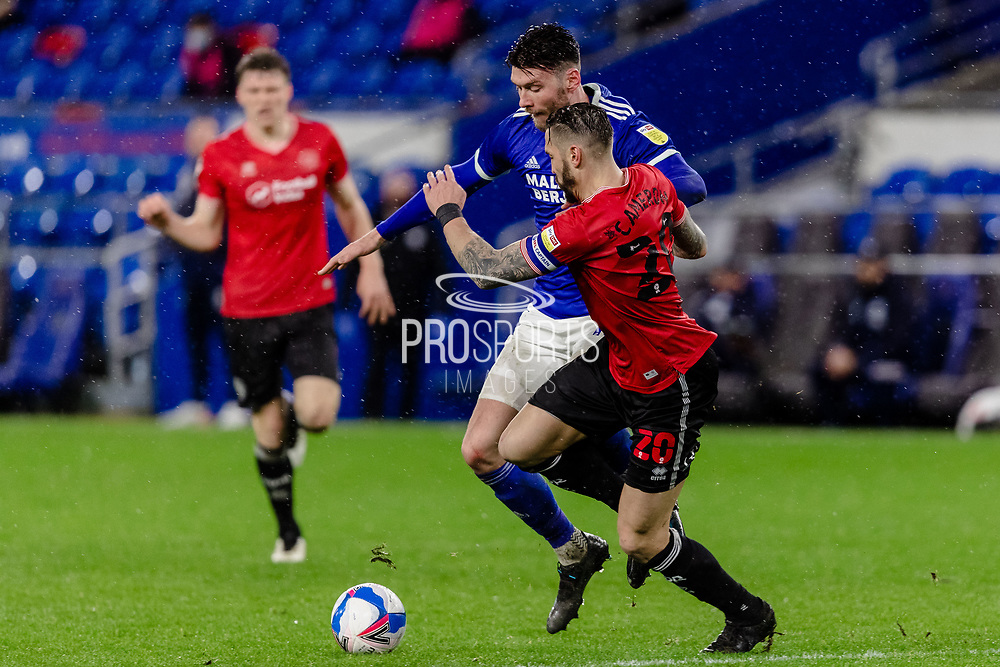 Queens Park Ranger's Geoff Cameron looks to block Cardiff City Kieffer Moore shot during the EFL Sky Bet Championship match between Cardiff City and Queens Park Rangers at the Cardiff City Stadium, Cardiff, Wales on 20 January 2021.