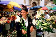 ECUADOR, HIGHLANDS, CUENCA students in main flower market