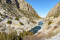 Wind River Canyon is a scenic canyon just south of Thermopolis, Wyoming. The canyon cliffs are up to 2500 feet high. A railroad and Highway 20 pass through the canyon on either side of the river. This view is near the northern entrance of the canyon.