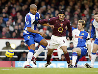 Photo: Chris Ratcliffe.<br />Arsenal v Blackburn Rovers. The Barclays Premiership.<br />26/11/2005.<br />Jose Antonio Reyes (C) tries to get away from Andy Todd right and Steven Reid of Blackburn