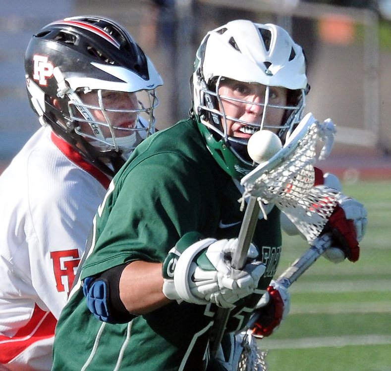 (Mara Lavitt — New Haven Register) <br /> May 29, 2014 West Haven<br /> SCC 2014 boys lacrosse championship at Ken Strong Stadium, West haven High School. Fairfield Prep 8, Guilford 5. FP's Burke Smith and Guilford's Nate Tepley.<br /> mlavitt@newhavenregister.com