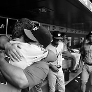 Bryce Harper, (left), Washington Nationals and teammate Dan Uggla hug in the dugout before the New York Mets Vs Washington Nationals MLB regular season baseball game at Citi Field, Queens, New York. USA. 31st July 2015. Photo Tim Clayton