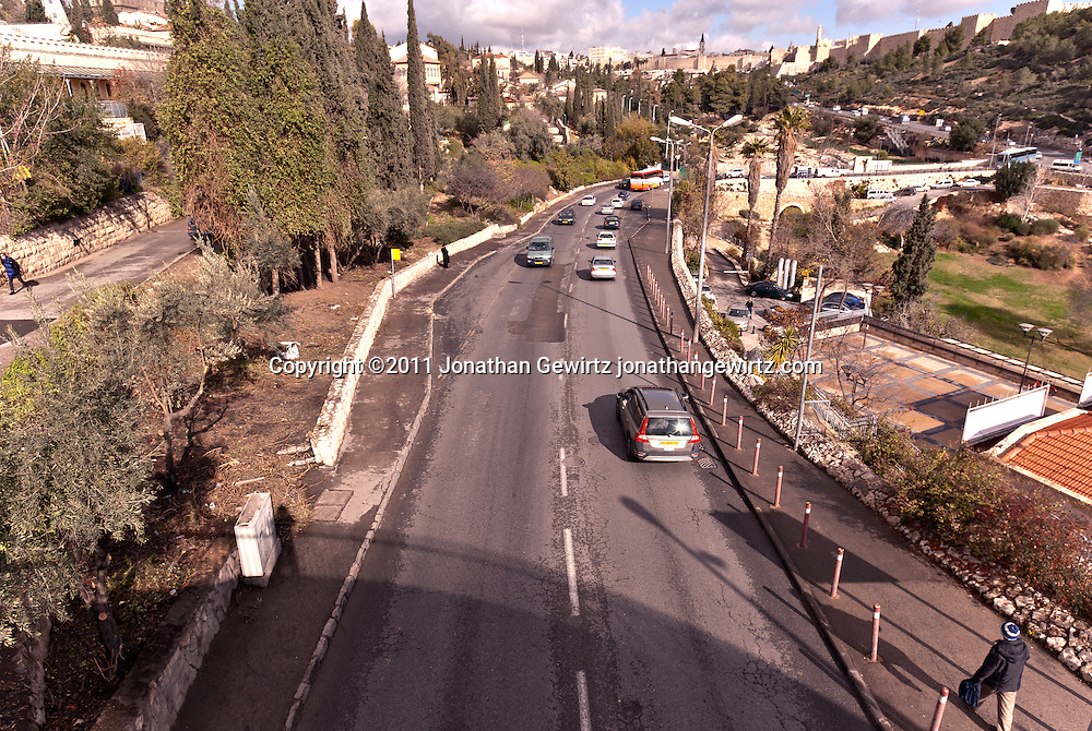 View along the Derech Hevron toward the Jaffa Gate and walls of the Old City of Jerusalem. WATERMARKS WILL NOT APPEAR ON PRINTS OR LICENSED IMAGES.
