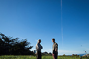 Stanford Director of Hopkins Marine Station Stephen Palumbi, left, and undergrad Austin Ayer discuss Ayer's shark fin project outside Stanford University's Hopkins Marine Station in Pacific Grove, California, on February 23, 2016. (Stan Olszewski/SOSKIphoto for Hakai Magazine)
