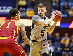 Mar 6, 2019; Morgantown, WV, USA; West Virginia Mountaineers guard Jordan McCabe (5) protects the ball from Iowa State Cyclones guard Nick Weiler-Babb (1) during the second half at WVU Coliseum. Mandatory Credit: Ben Queen-USA TODAY Sports
