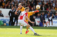 Sean Rigg of Newport county gets to the ball ahead of Daniel Parslow of Cheltenham Town. EFL Skybet football league two match, Newport county v Cheltenham Town at Rodney Parade in Newport, South Wales on Saturday 10th September 2016.<br /> pic by Andrew Orchard, Andrew Orchard sports photography.
