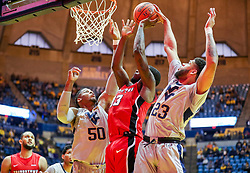 Dec 1, 2018; Morgantown, WV, USA; Youngstown State Penguins forward Naz Bohannon (33) shoots in the lane while defended by West Virginia Mountaineers forward Sagaba Konate (50) and West Virginia Mountaineers forward Esa Ahmad (23) during the first half at WVU Coliseum. Mandatory Credit: Ben Queen-USA TODAY Sports