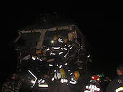 JIAMUSI, CHINA - OCTOBER 24:    China Out - Finland Out<br /> <br /> One Dead In Northeast China Train-truck Collision<br /> <br /> Rescuers work at a train-truck collision site on October 24, 2013 in Jiamusi, Heilongjiang Province of China. A driver of a passenger train was killed and ten others injured after the train collided with a coal-loaded truck at a rail crossing on Thursday morning. <br /> ©Exclusivepix