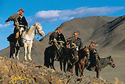 Kazakhs with their Golden Eagles<br />Aquila chrysaetos<br />Western Mongolia
