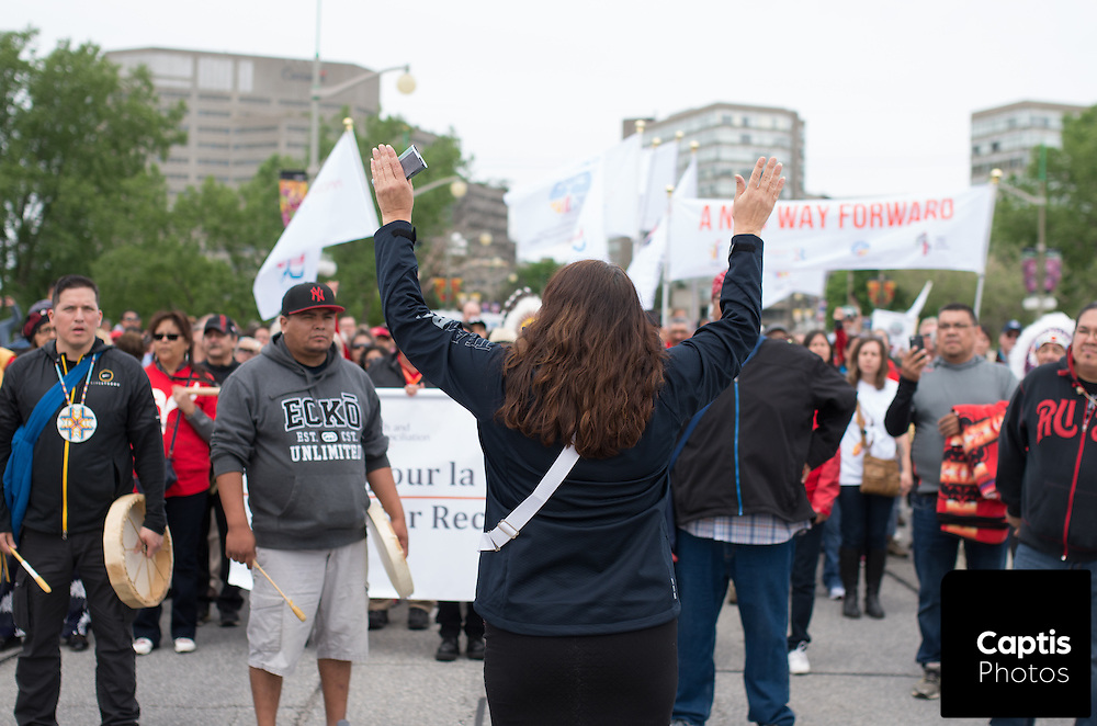 """Thousands of people take part in a """"Reconciliation Walk"""" through Hull and Ottawa two days before the Truth and Reconciliation Commission of Canada is to release it's final report which documents the treatment of aboriginals who were forced into residential schools. May 31, 2015.<br /> Captis Photos/Brendan Montgomery"""