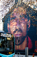 AFL legend Adam Goodes mural painted by Apparition Media on the side of a building on the corner of Crown and Foveaux Street in Surry Hills. Adam Goodes, a two-time Brownlow medallist and Australian of the Year recipient, who retired from AFL in 2015. Goodes' retirement came after he received repeated racial abuse and booing by fans due to his speaking out against racism in the game. The mural was supposed to be painted in February but was postponed because of COVID-19. (Photo be Pete Dovgan/ Speed Media)