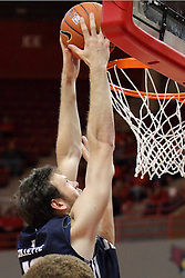 16 November 2014:  Slam dunk by David Collette during an NCAA non-conference game between the Utah State Aggies and the Illinois State Redbirds.  The Aggies win the competition 60-55 at Redbird Arena in Normal Illinois.