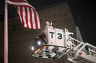 Middletown, NY - Santa Claus gets ready to light Holiday tree from a fire truck  on Nov. 27, 2009.