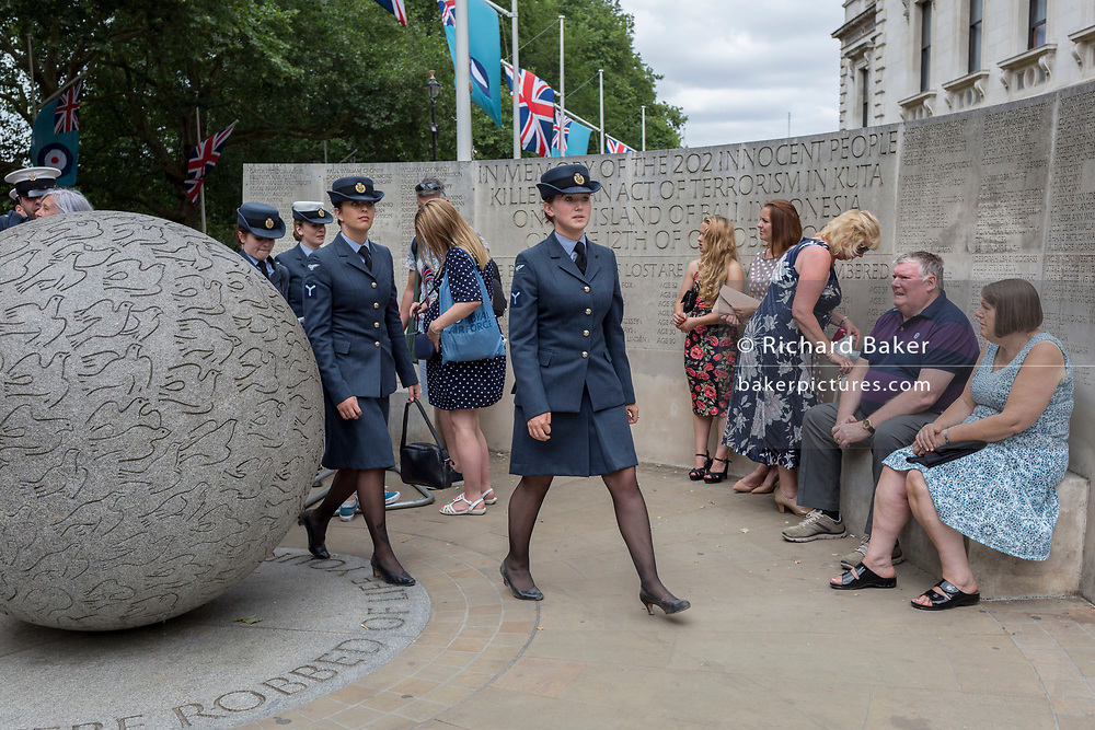 On the 100th anniversary of the Royal Air Force (RAF) and following a flypast of 100 aircraft formations representing Britain's air defence history which flew over central London, women service personnel leave Horseguards, passing the memorial to those killed in the 2002 Bali bombing, on 10th July 2018, in London, England.