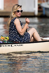 © London News Pictures. 05/07/2012.  Henley-on-Thames, UK. A young lady enjoying a boat ride along the River Thames in the sunshine on Day three of Henley Royal Regatta on the River Thames at Henley-on-Thames, Oxfordshire on July 03, 2013. The 5 day regatta over the first weekend in July, races head-to-head knock out competitions over a course of 1 mile between rowing teams from throughout the world. Photo credit: Ben Cawthra/LNP
