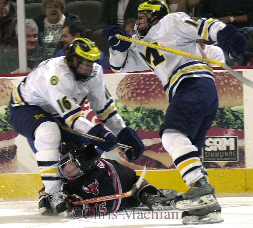 CM-12/13/03 Omaha, NE  UNO's David Morelli runs into Michigan's David Rohlfs during the first period  Saturday night at the Qwest Center Omaha. (photo by Chris Machian/Prairie Pixel Group)