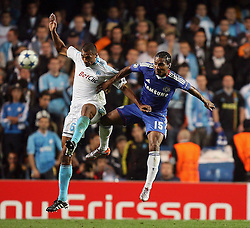 28.09.2010, Stamford Bridge, London, ENG, UEFA Champions League, Chelsea vs Olympique Marseille, im Bild Florent Malouda of Chelsea       and OM's Edouard Cisse  during the Match Chelsea v Marseille, Group F, of  the UCL ( Uefa Champions League Group stages)  at Stamford Bridge in London. EXPA Pictures © 2010, PhotoCredit: EXPA/ IPS/ Marcello Pozzetti +++++ ATTENTION - OUT OF ENGLAND/UK +++++ / SPORTIDA PHOTO AGENCY