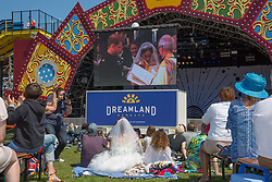 @Licensed to London News Pictures 19/05/2018. Margate, UK. Hundreds of members of the public enjoying watching the Royal wedding of Prince Harry to Ms Megan Markle on the big screen at Dreamland Margate today in the bright sunshine. Photo credit: Manu Palomeque/LNP