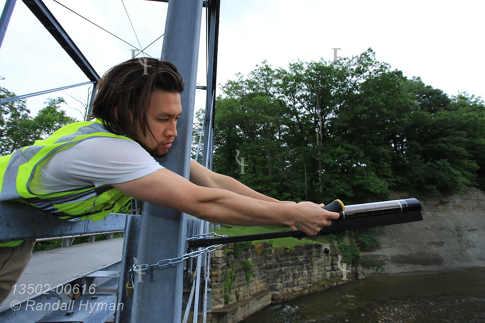 Hyfi CEO Brandon Wong installs wireless water-level sensor on Pleasant Valley Road Bridge on the Chagrin River for the Northeast Ohio Regional Sewer District in Willoughby Hills a suburb of Cleveland, Ohio.