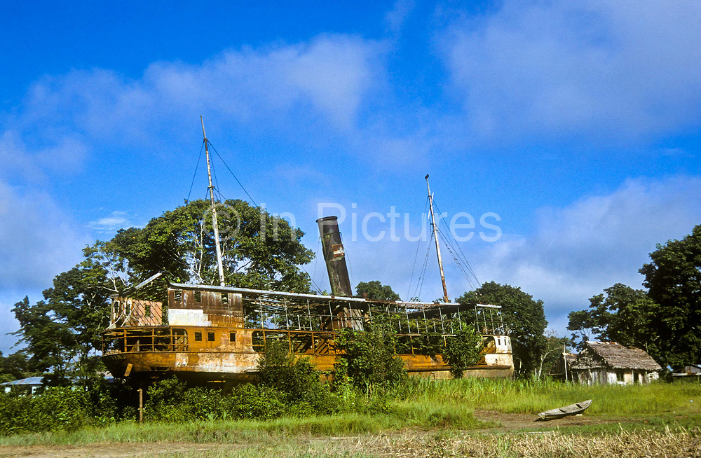 """The rusting remains of the paddle steamer used by film director Werner Herzog in the making of the film """"Fitzcarraldo"""" close to the Amazon river city  town of Iquitos, Perú."""