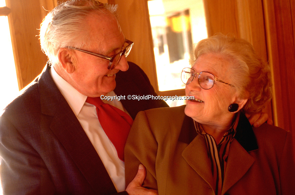 Senior couple gazing affectionately at each other age 75.   St Paul Minnesota USA