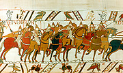 Bayeux Tapetry 1667: William the Conqueror's Norman cavalry setting out to meet Harold II's English forces, Battle of Hastings, 14 October 1066. Textile Linen
