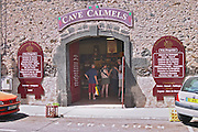 Cave Calmels wine shop with publicity boards outside. Agde town. Languedoc. France. Europe.