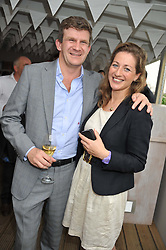 The HON.PEREGRINE HOOD and CAMILLA WILSON at a party to celebrate the publication on 'Let's Eat: Recipes From My Kitchen Notebook' by Tom Parker Bowles held at Selfridge's Rooftop. Selfridge's, Oxford Street, London on 27th June 2012.