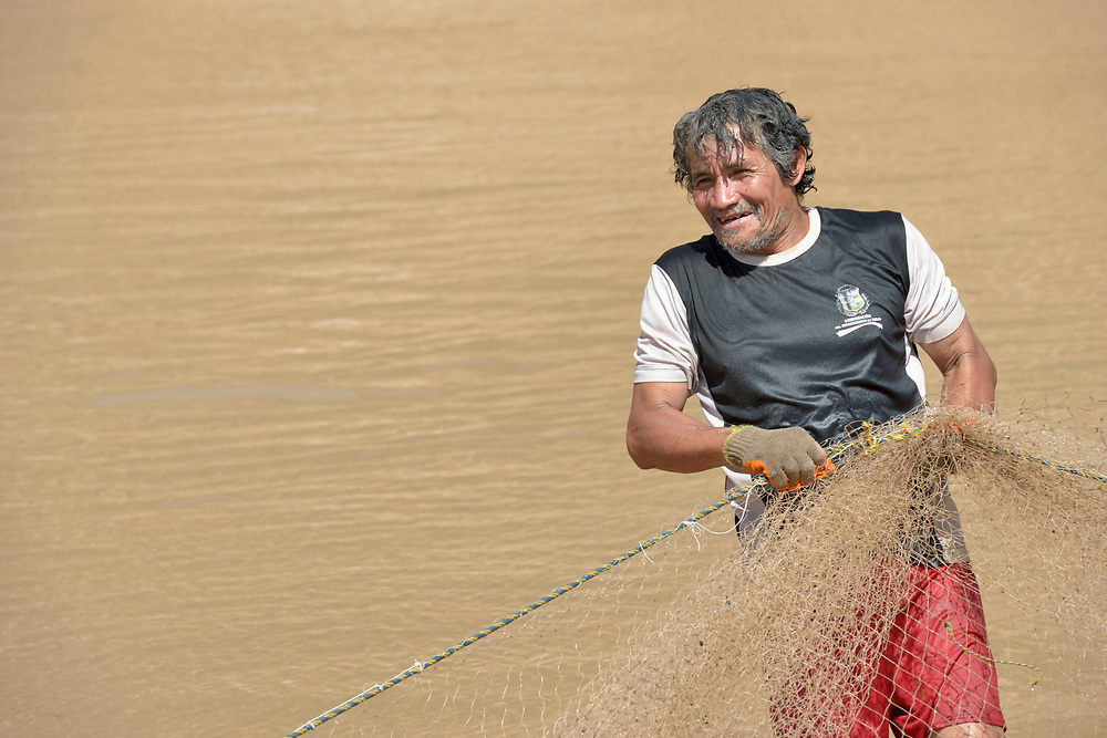A Weenhayek indigenous man pulls a fishing net from the Pilcomayo River outside of Villamontes, Bolivia. The river has been plagued by contamination from upstream mining and road construction, and the Weenhayek have had to struggle against large agricultural plantations and cattleraisers to retain access to the river.