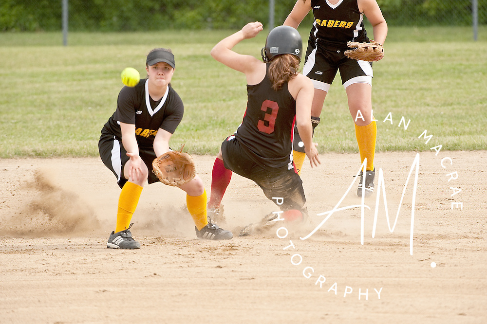 Laconia's Caitlyn Zelonis makes it safely to second base as Souhegan second baseman Ali Sumski waits for the ball during Wednesday's tournament preliminary game at Laconia's Memorial Park.  (Alan MacRae/for the