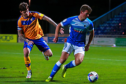 Andy Cook of Mansfield Town chases down Josh Granite of Barrow - Mandatory by-line: Ryan Crockett/JMP - 27/10/2020 - FOOTBALL - One Call Stadium - Mansfield, England - Mansfield Town v Barrow - Sky Bet League Two