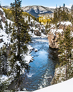 Firehole River Canyon in winter. A pretty little chasm in Yellowstone National Park.   The only way to see this in winter is by snowcoach or snowmobile.