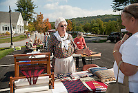 Marlene Witham explains her weaving process to Debbie Frawley Drake on Saturday during Gilford's fifth annual Heritage Festival.  (Karen Bobotas/for the Laconia Daily Sun)