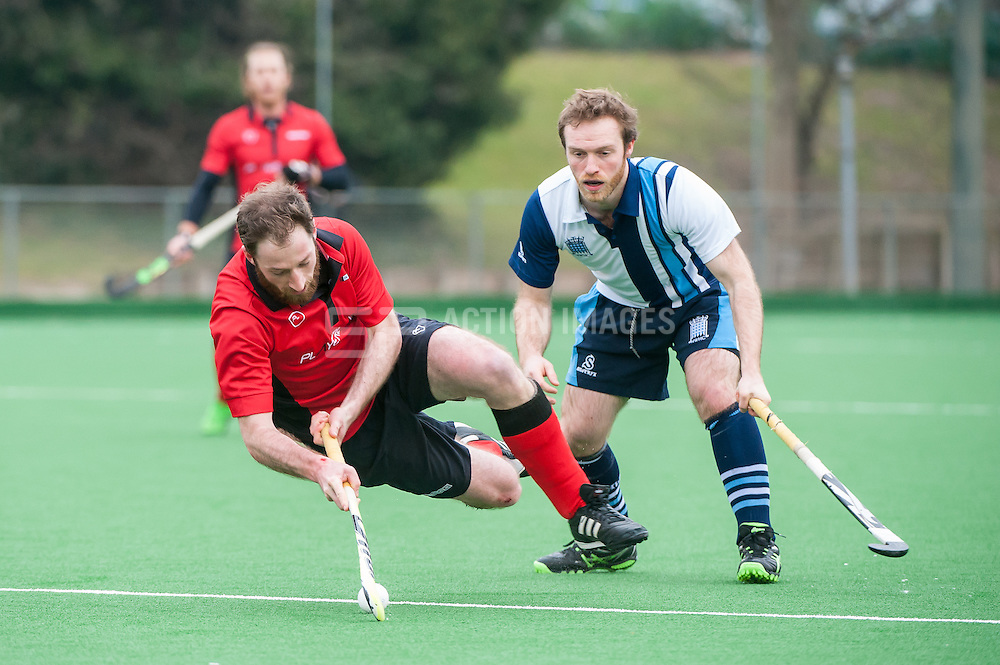 Southgate's Mike Houlihan gets some air. Southgate v Hampstead & Westminster - Now: Pensions Hockey League Premier Division, Trent Park, London, UK on 14 March 2015. Photo: Simon Parker