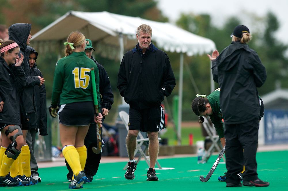 Coaches and players on the sidelines during the women's field hockey game between the Maine Black Bears and the Vermont Catamounts at Moulton/Winder Field on Saturday afternoon September 29, 2012 in Burlington, Vermont.