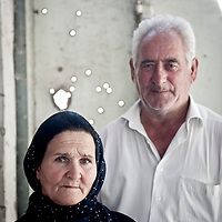 Chiragly, Azerbaijan 25 July 2012<br /> Mr. Khosrov Shukurov, 70 years old and his wife Nushaba Shukurova, 65 years old pose for the photographer inside their house located at 150 meters of the fire line. They said to the journalists that they currently get shoot by Armenian snipers.<br /> Photo: Ezequiel Scagnetti