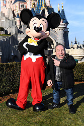 Warwick Davis (R) and Mickey pose in front of Sleeping Beauty Castle during the launch of Star Wars: Season Of The Force on January 21, 2017 in Disneyland Paris, France. Photo by Jon Furniss/Disney/ABACAPRESS.COM