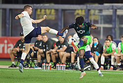 NEW YORK, NEW YORK, USA - Wednesday, July 24, 2019: Liverpool's James Milner (L) challenges Sporting CP's Thierry Rendall Correia (R) during a friendly match between Liverpool FC and Sporting Clube de Portugal at the Yankee Stadium on day nine of the club's pre-season tour of America. (Pic by David Rawcliffe/Propaganda)