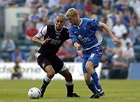 Photo: Olly Greenwood.<br />Gillingham v Swansea City. Coca Cola League 1. 16/09/2006. Swansea's Darren Pratley (L) and Gillingham's Mark Bentley battle.