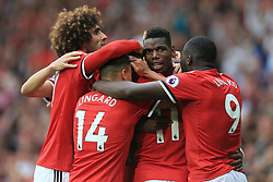 13th August 2017 - Premier League - Manchester United v West Ham United - Paul Pogba of Man Utd (C) celebrates with teammates including Marouane Fellaini (L) after scoring their 4th goal - Photo: Simon Stacpoole / Offside.