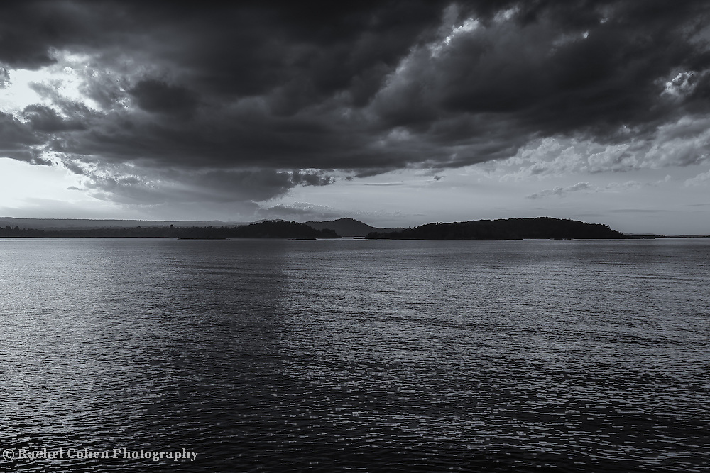 """""""The Reckoning in Gray"""" <br /> <br /> Beautiful Lake Superior as seen from Presque Isle Park in Marquette Michigan. A scene of darkness and light with heavy dramatic skies, with islands and land in silhouette! a wonderful lack and white Michigan landscape!"""