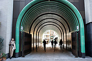Silhouette people pass through new archway to a development called Rathbone Square off Rathbone Place on 21st January 2020 in London, England, United Kingdom. Rathbone Square is a new development and retail space in Fitzrovia.