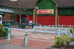 © Licensed to London News Pictures. 01/04/2021. Reading, UK. Police tape marks a cordon outside an Iceland store following a serious incident of assault outside a BP petrol station on Chalfont Way, Lower Earley, Reading which occurred at approximately 7:40pm on Wednesday 31/03/2021, a 51-year-old man was taken to the Royal Berkshire Hospital in a critical condition with life-threatening injuries. Photo credit: Peter Manning/LNP